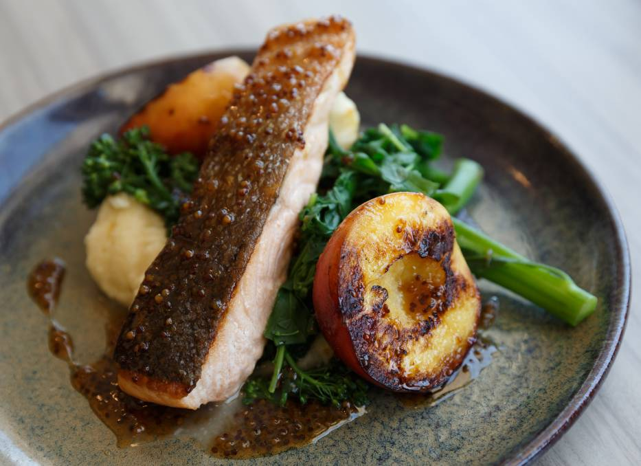 FLAVOURS: The crispy skinned maple-glazed salmon with grilled peaches.